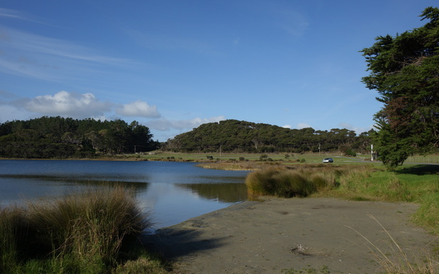 Lake Ngatu now discoloured by run off from nearby kauri mining.