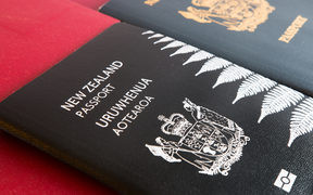 A New Zealand passport with silver fern on a red background (file photo)