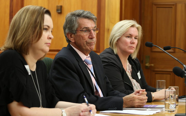 Chief Ombudsman Judge Peter Boshier (center), Deputy Ombudsman Compliance  and Practice Emma Leach (left) and Chief Inspector OPCAT Jacki Jones, (right) speak to the Law and Order Committee about the illegal restraint of at risk prisoners.