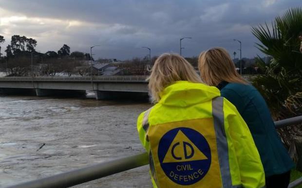 Civil Defence Minister Nikki Kaye and Whanganui Mayor Annette Main by the still very swollen Whanganui River.