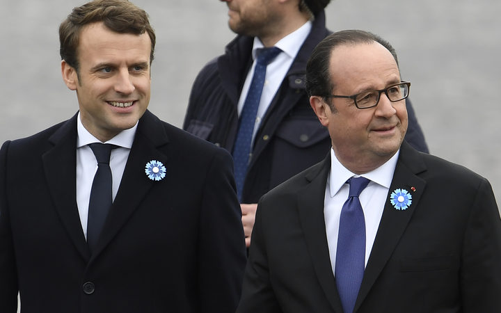 Outgoing French President Francois Hollande (R) and French president-elect Emmanuel Macron arrive to attend a ceremony marking the 72nd anniversary of the victory over Nazi Germany during World War II.