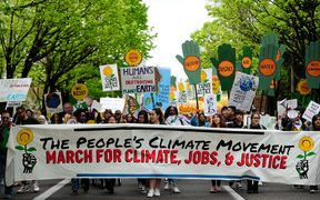 Protesters take part in the People's Climate March in Portland, US.