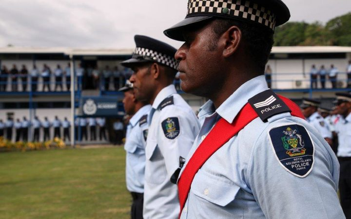 Solomon Islands Police officers at the official limited-rearmament ceremony marking the first time in 14 years that RSIPF officers gave been allowed to carry guns.
