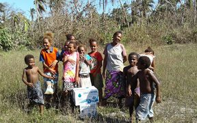 Children getting water on Hui in Torres.