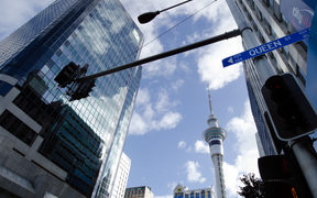 A clear day in Auckland, with the Sky Tower in the background and a Queen St sign in the foreground (file photo)