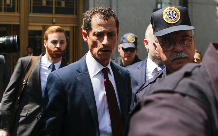 Anthony Weiner leaves court in Manhattan after pleading guilty to one charge of sending obscene messages to a minor.