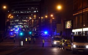 Ambulances arrive at the scene at Manchester Arena following blasts at an Ariana Grande concert.