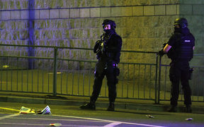 Police stand guard outside Manchester Arena after a blast