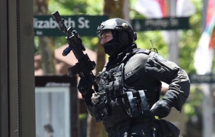 An armed officer outside the Lindt cafe during the 2014 Sydney seige.
