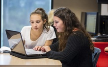 Stock photo of students using technology