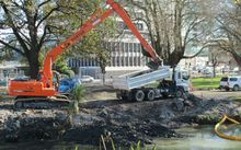 Quake repair work continues on the banks of the Avon River.