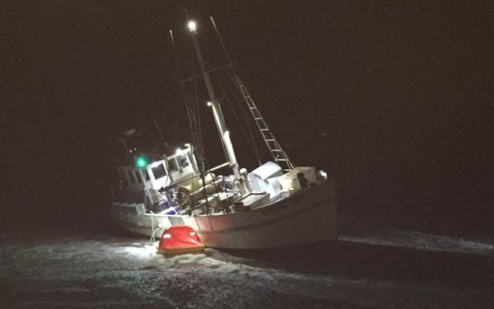 Fishing boat aground at Cobden Beach