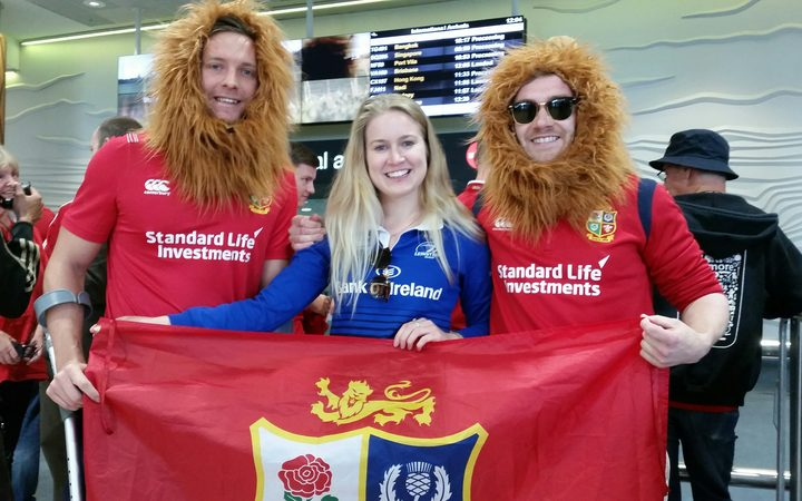 British and Irish Lions' fans await their arrival at Auckland airport.