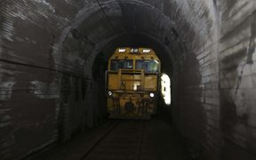 Train stuck between in a tunnel between slips.