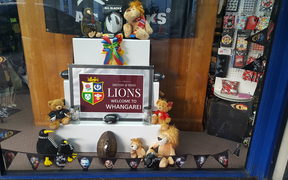 Whangārei puts out the welcome mat for the Lions: display in Rathbone Gifts window.