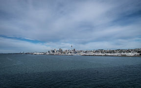 Auckland cityscape over looking water from the Auckland harbour bridge