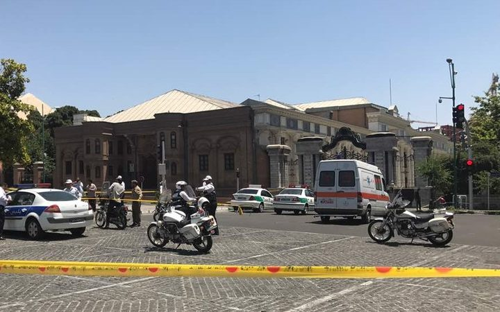 Police take security measures at the scene after gunmen opened fire at Iran's parliament and the shrine of Ayatollah Khomeini in the capital Tehran, Iran on June 7, 2017.