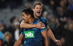 Rieko Ioane scores a try and celebrates with Matt Duffie.