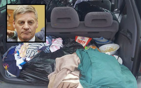 Bill English, boot of car being lived in.