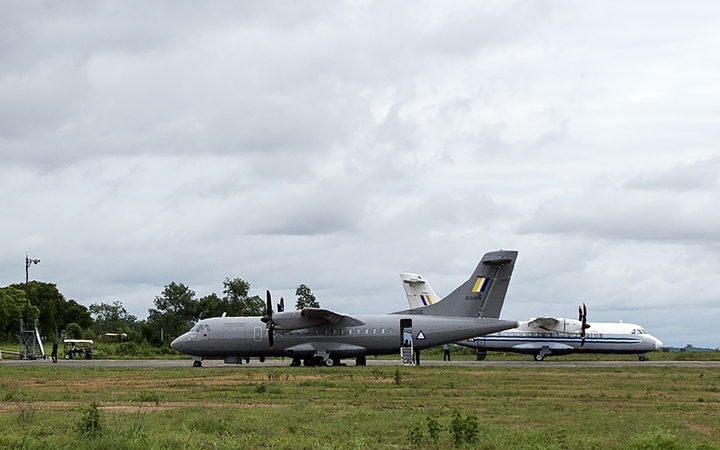 A Myanmar Air Force plane (L) is pictured at Dawei Airport on 8 June 2017, the day after a military plane disappeared off the coast of Launglon, in southern Myanmar