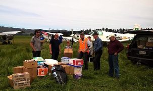 Members of the farming community come together to get supplies out to isolated farmers.
