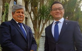 New Zealand First MP Mahesh Bindra and Labour MP Raymond Huo standing outside Parliament.