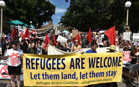 A large number of people from different walks of life holding banners and placards marched to the US consulate protesting against Trump's travel ban policy and demanded Australian government to settle all the refugees and asylum seekers in the county.