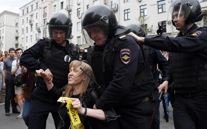 Russian police officers detain Maria Baronova, a coordinator of Khodorkovsky's Open Russia organization as she participates at the unauthorized opposition rally in Tverskaya street in central Moscow on June 12, 2017.