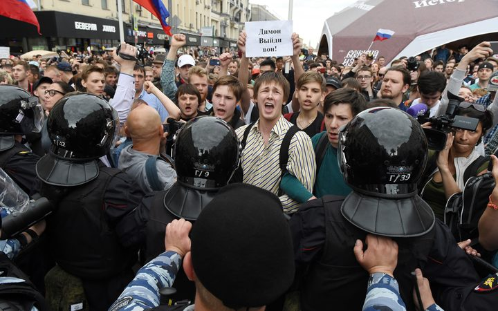 People gather on Tverskaya street during an unauthorized opposition rally in Moscow on June 12, 2017.