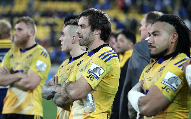 Dejected Hurricanes players Ma'a Nonu, Conrad Smith & TJ Perenara after their loss to the Highlanders in the Super Rugby Final.