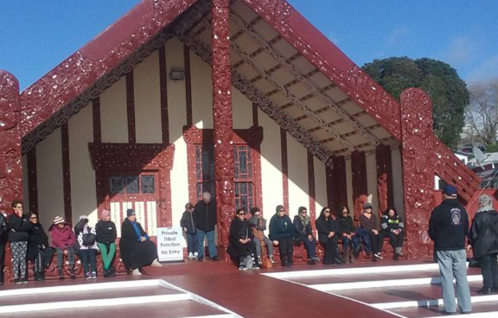 Iwi members gather at Tama te Kapua at Ohinemutu after marching to the Rotorua hospital.