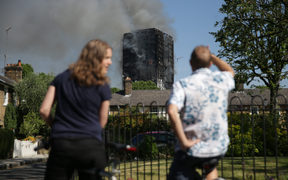 Local residents watch smoke billow from Grenfell Tower,