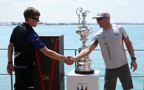 Team NZ helmsman Peter Burling, left, and Oracle Team USA's skipper Jimmy Spithill with the America's Cup Trophy, the Auld Mug.