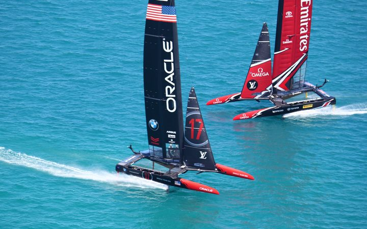 Team New Zealand and Oracle during racing on the second day of the America's cup final racing.