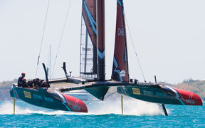 Emirates Team New Zealand rounds the top mark ahead of Oracle Team USA in race four on day two of the America's Cup.