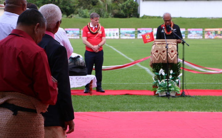 Tonga's prime minister 'Akilisi Pohiva (right) in an All Blacks jersey speaking at the reopening of Teufaiva Stadium in Nuku'alofa as New Zealand prime minister Bill English, in an 'Ikale Tahi jersey looks on. 16 June 2017