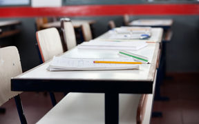 Empty desks in school classroom