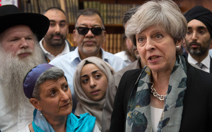 Prime Minister Theresa May talks to faith leaders at Finsbury Park Mosque in north London.