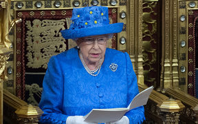 The Queen sits alongsides Prince Charles as she delivers the Queen's Speech.