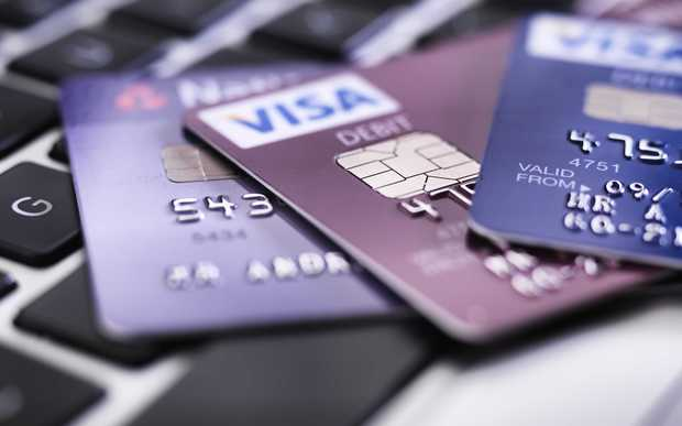 Credit card on laptop illustrating online shopping and banking.