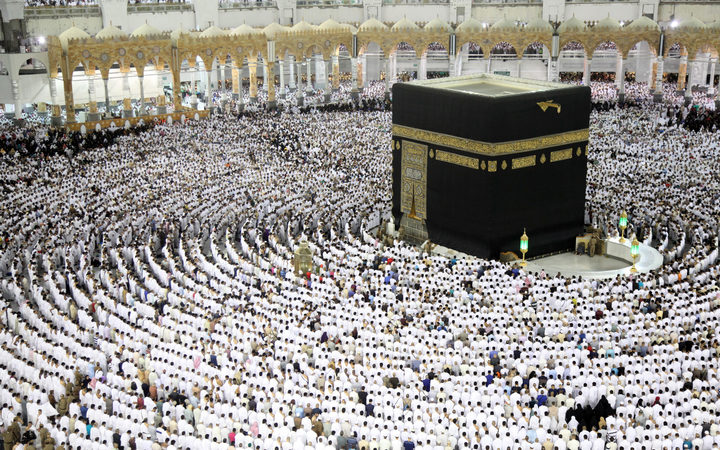 Muslim worshippers pray at the Kaaba, Islam's holiest shrine, at the Grand Mosque in Mecca on 23 June 2017, during the last Friday of the holy month of Ramadan.