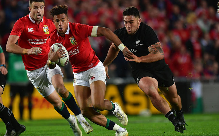 Lion's Anthony Watson is tackled by All Blacks Codie Taylor during the All Blacks vs British and Irish Lions at Eden Park.