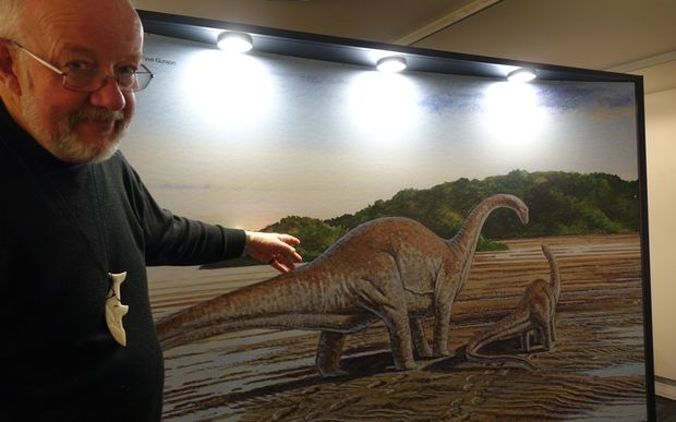 Nelson Provincial Museum chief executive Peter Millward points out an artist's impression of the type of dinosaur that once strolled around northwest Nelson.