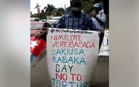 Jope Koroisavu makes a lone anti-torture protest on the pavements of Suva, marking UN Day in Support of Victims of Torture on 26 June 2017