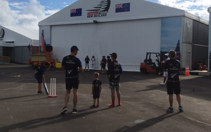 Members of Team NZ celebrate their history-making win with a game of cricket with their kids.