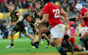 Hurricanes' Julian Savea runs the ball .
