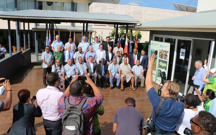 The media pack making the most of the photo op of Pacific Islands leaders posing with some of the great minds behind RAMSI including, senior Police executives, former RAMSI special coordinators and politicians as well as regional experts.