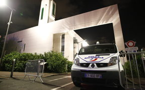 A police van stationed at at the mosque in the Paris suburb of Creteil where a man tried to drive a car into a crowd.