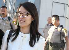 Ellen Pao (R) leaves the San Francisco Superior Court Civic Center Courthouse with her attorney Therese Lawless on March 27, 2015. A jury found no gender bias against her.