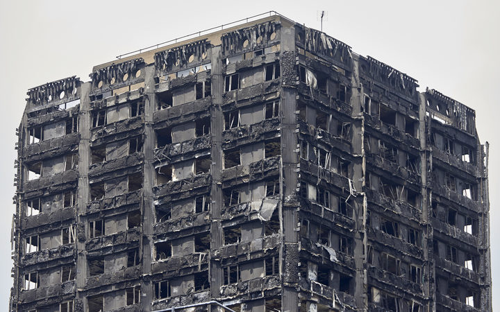 The charred remains of clading are pictured on the outer walls of the burnt out shell of the Grenfell Tower block in north Kensington, west London on June 22, 2017.